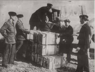 Emergency Aid: ATA pilots load medical supplies destined for the Czech Republic in 1945