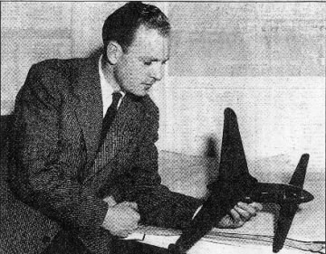 George Miles (1944) with a model of the canard-wing Libellula aeroplane which he later test piloted.